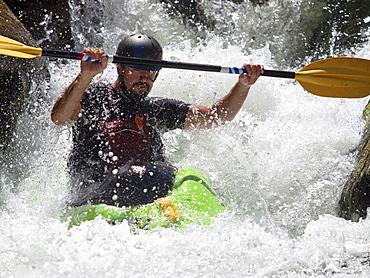 Man kayaks in whitewater rapids on Wilson Creek, NC.