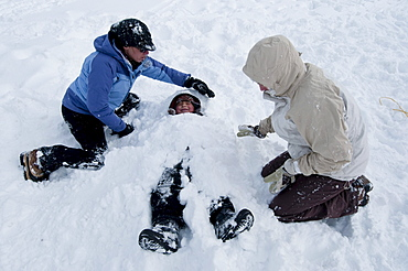 A young boy gets buried in the snow in Incline Village, Nevada.