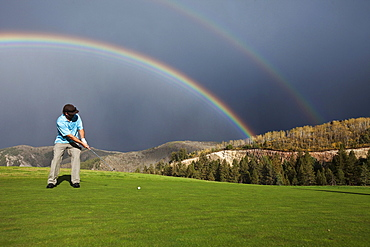 A golfer putts under an amazing double rainbow in Colorado.