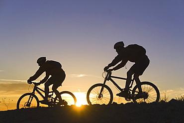 Mountain biking at sunset in California.