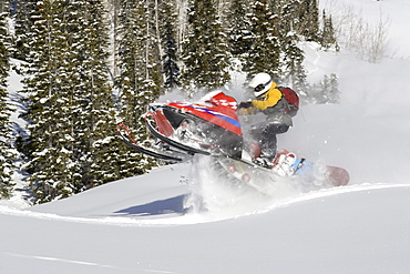 Snowmobiling in the mountains.