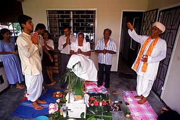 Hindustani celebration for 58th birthday of woman Dhanradjie Kalloe in Paramaribo, Suriname.