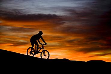 mountain biker at sunset, Moab, Utah
