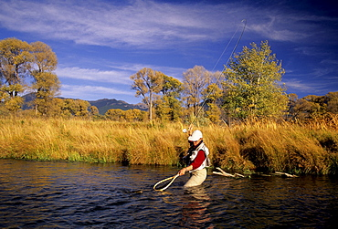 A person netting trout on the Bighorn River in Montana.