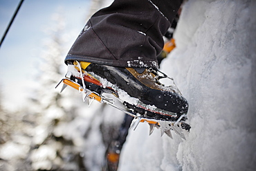 Boots and crampons on an ice wall in Whistler, British Columbia, Canada, Whistler, British Columbia, Canada