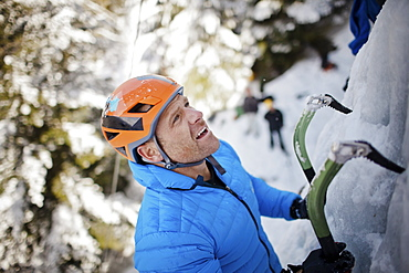 A ice climber looks for his next hold in Whistler, British Columbia, Canada, Whistler, British Columbia, Canada