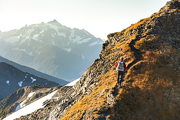 Hiking in the North Cascade Mountains with Mount Shuksan in the background, North Cascades National Park, Washington, United States