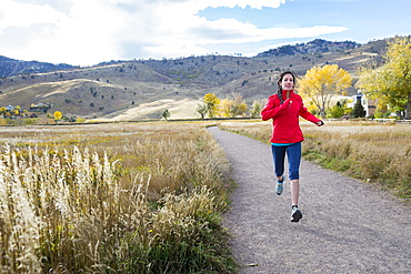 Female running outside alone in the foothills of Boulder, Colorado, Boulder, Colorado, United States