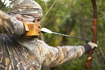 Bow Hunter aims recurve bow, Pagosa Springs, CO, USA