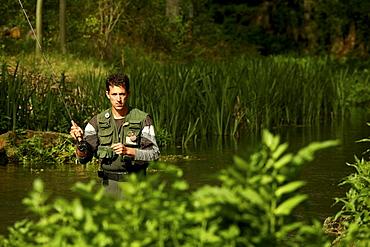 Man fishing in the river Gallo. Alto Tajo Natural Park. Guadalajara. Spain