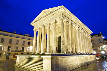 Maison Carrée ancient Roman temple on Place de la Maison Carrée at night, Nîmes, Languedoc-Roussillon, Gard Department, France