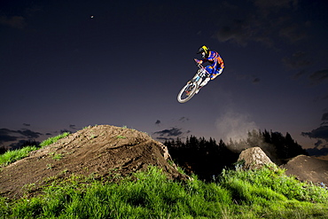 A young man jumps at the dirt track on a clear night near Toluca, Mexico