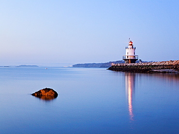 Maine's Spring Point lighthouse, near the entrance to Portland Harbor, is seen at twighlight.