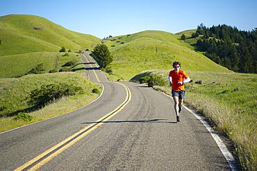 Man runs trails in the Marin Headlands in California.