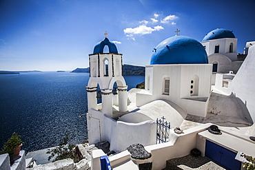 Blue domed rooftops in Santorini, Greece.