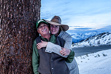 Couple with snowy mountains in the background