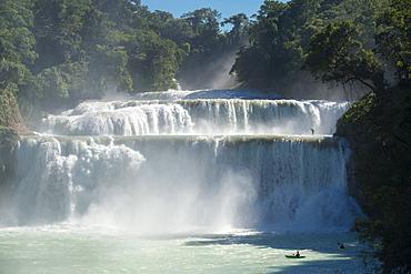 A group of kayakers descending waterfalls in Cascadas de Agua Azul, Chiapas, Mexico.