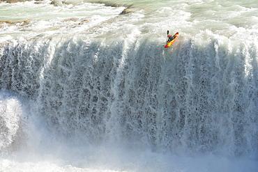 One kayaker dropping a waterfall in Cascadas de Agua Azul, Chiapas, Mexico.