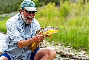 A man with a 21 inch Brown on the Green River