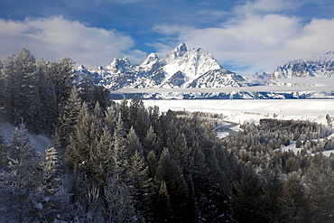 The Tetons rise above the Snake River in Grand Teton National Park, Wyoming, under fresh snow.