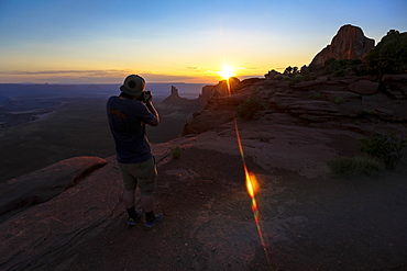 A photographer shoots the sunset at Canyonlands National Park near Moab, Utah.