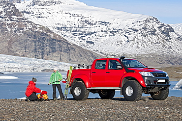 couple getting ready for skitouring in front of customised SUV / Icelandic superjeep