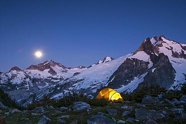Glowing tent at dusk, White Rock Lakes along the Ptarmigan Traverse, North Cascades, Washington