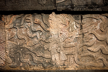 The image of a Toltec warrior with a snake in the right arm  and holding a human head with his left hand is displayed in the Mayan city of Chichen Itza, Yucatan Peninsula, Mexico