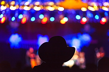 An audience member in a cowboy hat at the Telluride Bluegrass Festival in Telluride, Colorado.