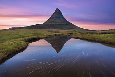 A reflection of Kirkjufell mountain on the Snaefellsnes peninsula in western Iceland.