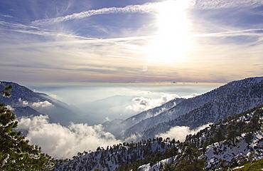 Sunlight over the San Gabriel Mountains seen from Devils Backbone on Mt Baldy.