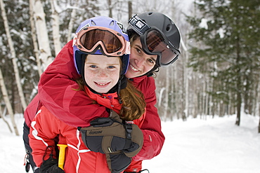 A mother and her child ski together at Sunday River ski resort in Bethel, ME, United States of America
