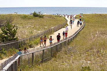 Beach goers walk down to Nantucket's popular Surfside Beach on the island's south side.