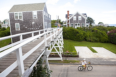 A bicyclist comes out after passing under the Siasconset foot bridge in Siasconset on the island of Nantucket.  08/18/14 Julia Cumes for the Boston Globe