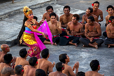 Traditional Indonesian dancers perform at Uluwatu Temple in Bali, Indonesia