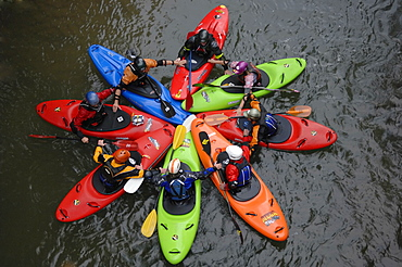 Eight Kayakers form a colorful circle before kayaking big whitewater on the Alseseca River in the Veracruz region of Mexico, United States of America