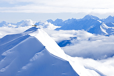 Coastal Helicopter flying over Chilkat Mountains in Haines, Alaska, United States of America