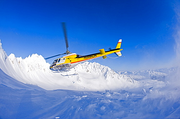 Coastal Helicopter taking off from Chilkat Mountains in Haines, Alaska, United States of America