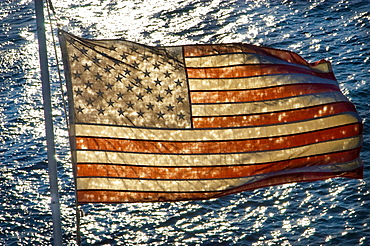 AMERICAN FLAG WITH LAKE IN BACKGROUND, United States of America