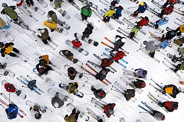 Aerial view of skiers and snowboarders standing in lift line at Mount Hood Meadows ski resort in Oregon Cascades, United States of America