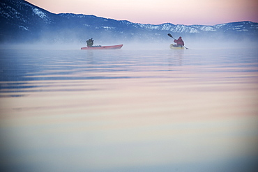 Corey Rich photographs Spencer Ray during an early morning paddle on Lake Tahoe, Stateline, NV, United States of America