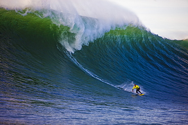 Jake Wormhoudt prepares for a bottom turn on a wave off Nelscott Reef on the Oregon coast, United States of America