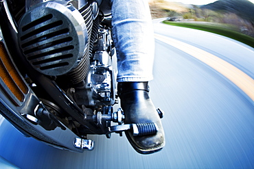 Two motorcycles weave through windy mountain roads, United States of America