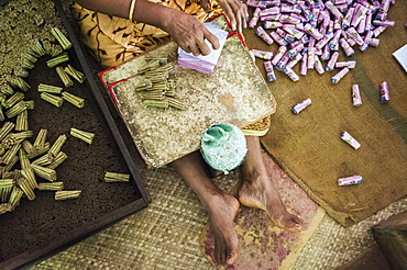A woman working in a cigarette (bidi or biri) factory near Kannur, Kerala, India.