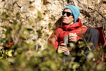 Climbing legend Patxi Usobiaga at the base of El Pati crag, Siurana, Spain.