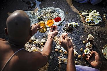 Performing a ceremony for the deceased family members at the Godavari river, Nashik, Maharashtra, India.