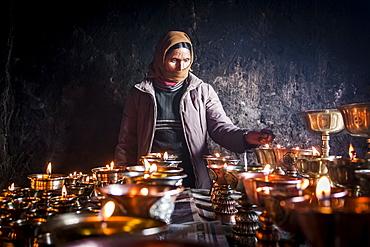 Butter lamps during Matho Nagrang festival in Matho monastery, Ladakh, India.