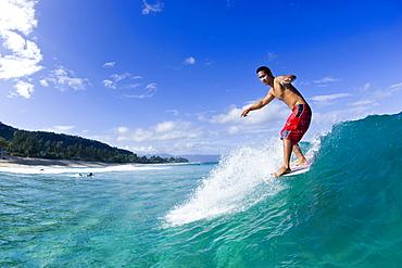 Longboard surfing at Pupukea, north shore,