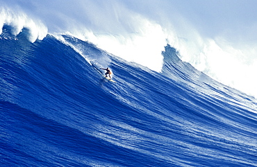 man surfing a huge wave off the coast of Oahu, Hawaii