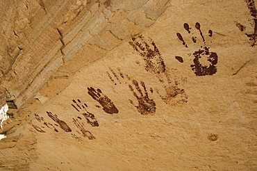 Pictographs of hand prints, made around 1000 AD by the Anasazi, ancestors to the Pueblo Indians of today, decorate a sandstone o
